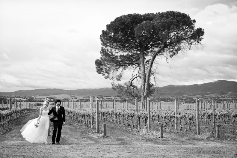 Bride and groom in vineyard at Stones of the Yarra Valley
