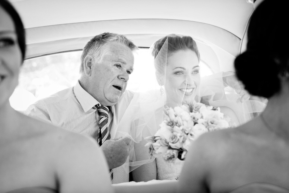 moment of Bride and her dad in the car out side the church Greek wedding, melbourne