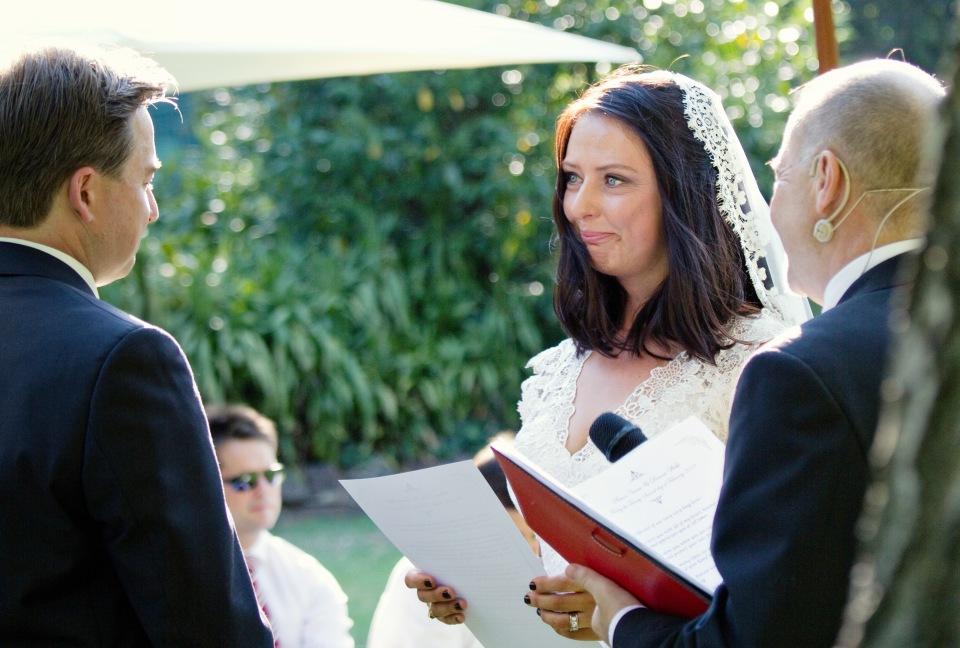 bride saying wedding vowswedding vows at outdoor melbourne garden wedding