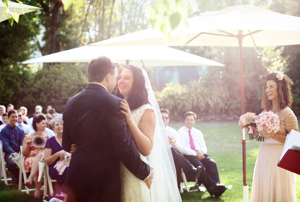 bride and groom first kiss in Melbourne garden ceremony
