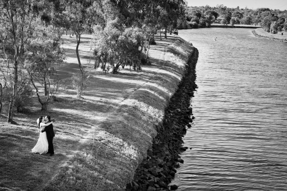 Bride and groom wedding photos by river in Melbourne
