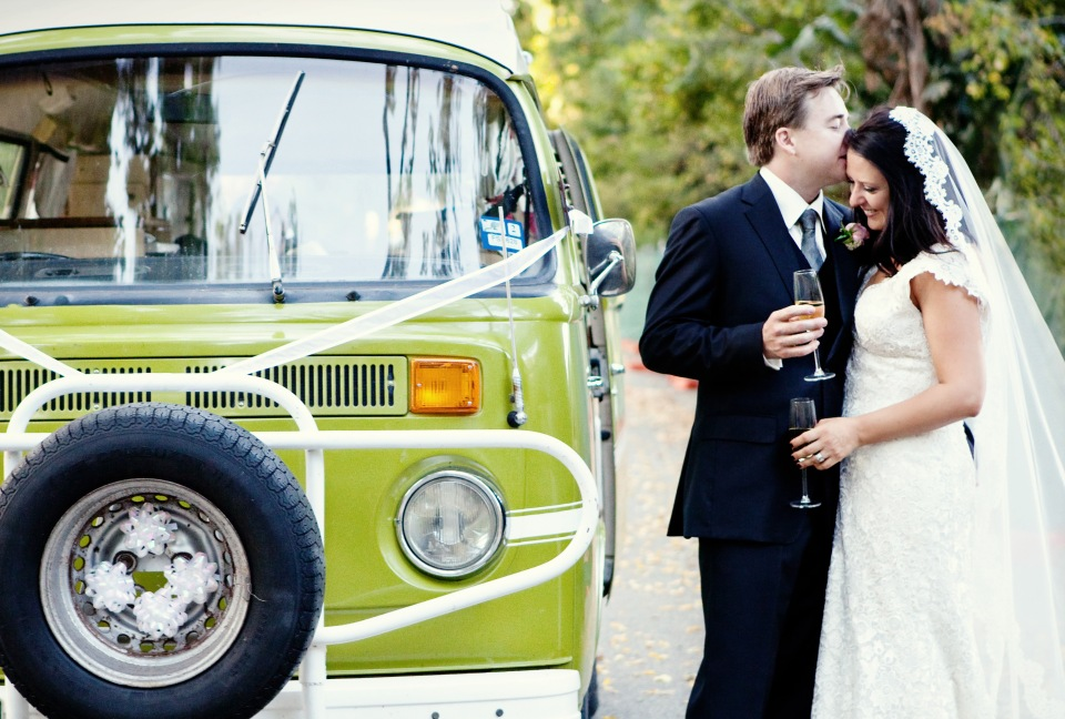 bride and groom with Kombi in Fitzroy Gardens