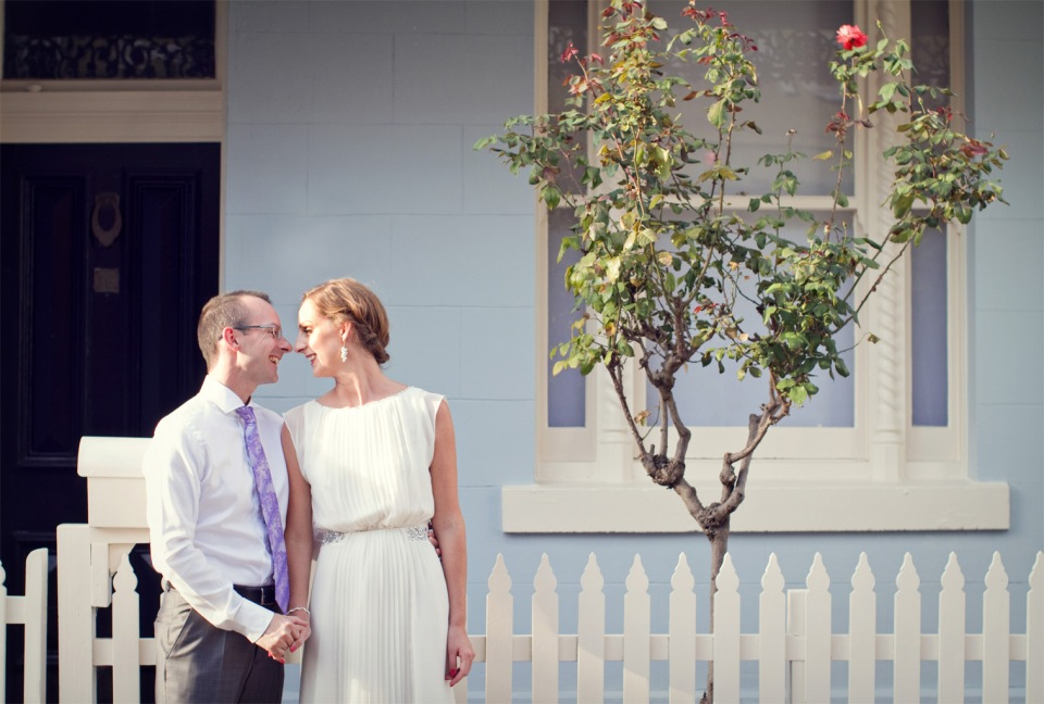 bride and groom in front of victorian house in Melbourne