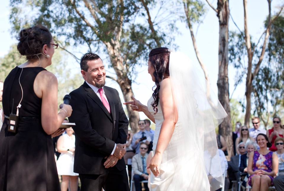 Natural wedding photos of the ceremony, bride and groom say vows