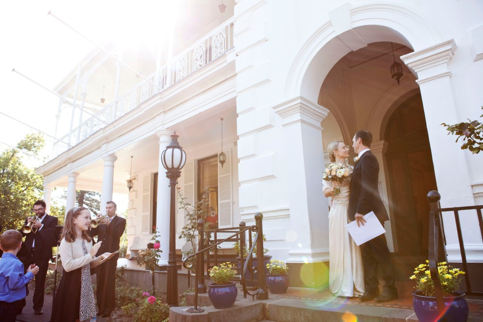 bride and groom kiss outside swedish church in Toorak Melbourne