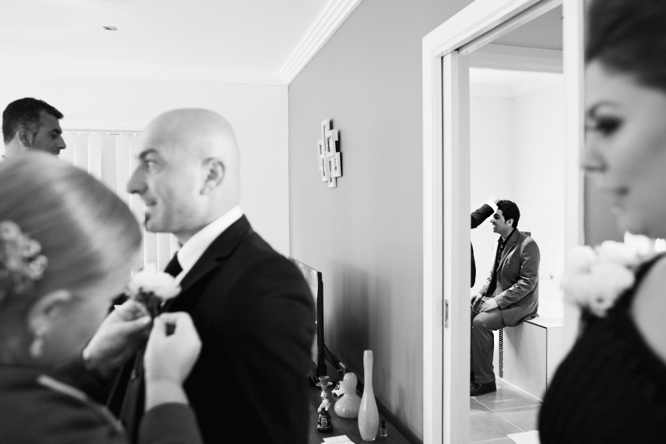 Melbourne wedding natural photos of guys getting ready, photojournalist