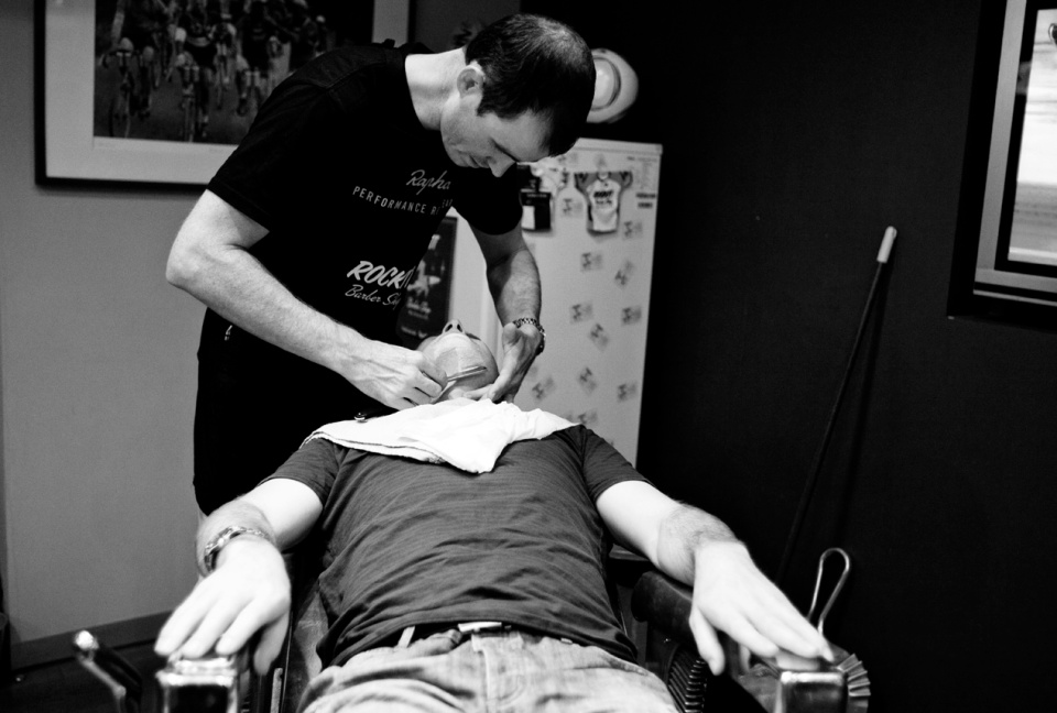 Groom getting a traditional shave at Rockit Barber - Melbourne wedding photography